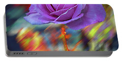 Portable Battery Charger featuring the photograph A Rose by Vladimir Kholostykh