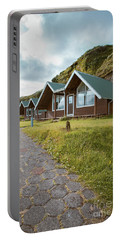 Portable Battery Charger featuring the photograph A Row Of Cabins In Iceland by Edward Fielding