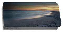 A Sandy Shoreline At Sunset Portable Battery Charger