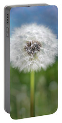 A Single Dandelion Seed Pod Portable Battery Charger