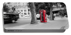 A Single Red Telephone Box On The Street Bw Portable Battery Charger