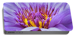A Sliken Purple Water Lily Portable Battery Charger