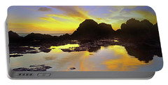 Portable Battery Charger featuring the photograph A Splatter Paint Sunset by Tara Turner
