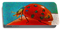 A Spring Lady Bug Portable Battery Charger