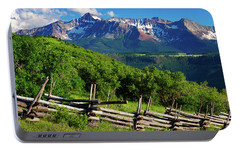 Portable Battery Charger featuring the photograph A Summer In Telluride by John De Bord