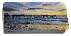 A Surfer Heads Home Under A Cloudy Sunset At Crystal Pier Portable Battery Charger