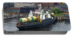 Portable Battery Charger featuring the photograph A Train Ferry In St Petersburg Carrying Freight by Clare Bambers