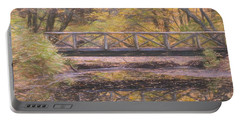 A Walking Bridge Reflection On Peaceful Flowing Water. Portable Battery Charger