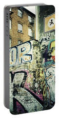 A Wall Of Berlin With Graffiti Portable Battery Charger