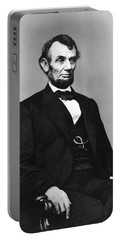 Portable Battery Charger featuring the photograph Abraham Lincoln Portrait - Used For The Five Dollar Bill - C 1864 by International  Images