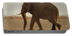 Portable Battery Charger featuring the digital art African Elephant Walk by Ernie Echols