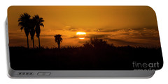 Portable Battery Charger featuring the photograph  African Style Sunset by Arik Baltinester