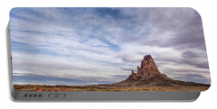 Portable Battery Charger featuring the photograph Agathla Wakes Up by Jon Glaser