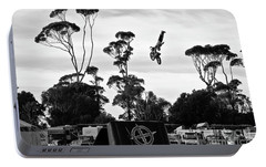 Portable Battery Charger featuring the photograph  Airborne Motorcycle Performance by Yurix Sardinelly