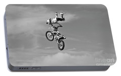 Portable Battery Charger featuring the photograph  Airborne Motorcycle by Yurix Sardinelly