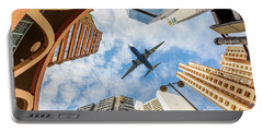 Airplane Above City Portable Battery Charger