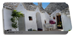 Alberobello Courtyard With Trulli Portable Battery Charger