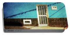 Portable Battery Charger featuring the photograph Alcala Blue Wall White Door by Anne Kotan