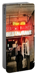 Portable Battery Charger featuring the photograph Along Bourbon Street - New Orleans by Glenn McCarthy Art and Photography