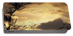 Amber Sky Portable Battery Charger by Glenn McCarthy Art and Photography