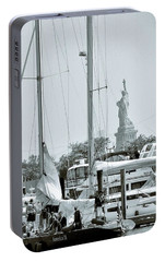 America II And The Statue Of Liberty Portable Battery Charger by Sandy Taylor