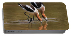 American Avocets Swishing Portable Battery Charger by Tom Janca