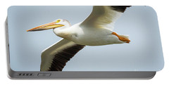 Portable Battery Charger featuring the photograph  American White Pelican Flyby  by Ricky L Jones