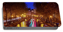 Portable Battery Charger featuring the photograph Amsterdam By Night by Barry O Carroll