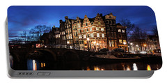 Portable Battery Charger featuring the photograph Amsterdam Canal Houses Illuminated At Dusk by IPics Photography