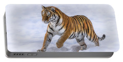 Portable Battery Charger featuring the photograph Amur Tiger Running In Snow by Rikk Flohr