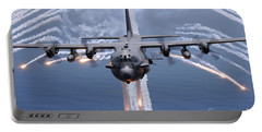 An Ac-130h Gunship Aircraft Jettisons Portable Battery Charger