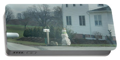 An Amish Snowman Portable Battery Charger