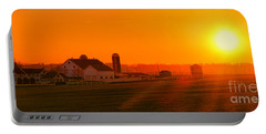 An Amish Sunset Portable Battery Charger