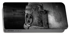 Portable Battery Charger featuring the photograph An Antique Stove by Doug Camara
