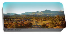 An Autumn Evening In Pagosa Meadows Portable Battery Charger by Jason Coward