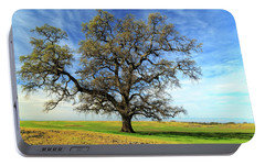 Portable Battery Charger featuring the photograph An Oak In Spring by James Eddy