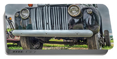 Portable Battery Charger featuring the photograph An Old Green Ford Truck by Guy Whiteley