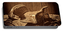 An Old Saddle Portable Battery Charger by American West Legend By Olivier Le Queinec