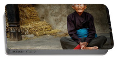 An Old Woman In Bhaktapur Portable Battery Charger