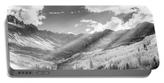 Portable Battery Charger featuring the photograph And You Feel The Scene by Jon Glaser