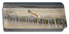 Portable Battery Charger featuring the photograph Antelope Jumping Fence 1 by Rebecca Margraf