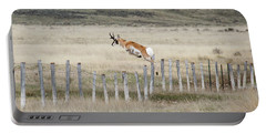 Portable Battery Charger featuring the photograph Antelope Jumping Fence 2 by Rebecca Margraf