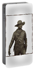 Portable Battery Charger featuring the photograph Antique Cowboy Sculpture by Ellen O'Reilly
