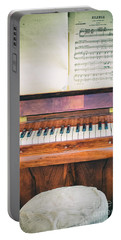 Portable Battery Charger featuring the photograph Antique Piano And Music Sheet by Silvia Ganora