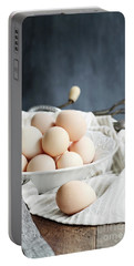 Apron And Eggs On Wooden Table Portable Battery Charger