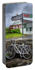 Portable Battery Charger featuring the photograph Aran Island Bicycles by Craig J Satterlee