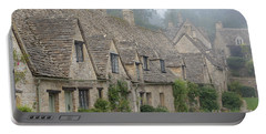 Arlington Row, Bibury In The Morning Fog Portable Battery Charger