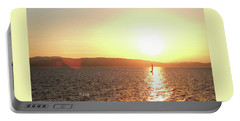 Portable Battery Charger featuring the photograph Solitary Sailboat by Felipe Adan Lerma
