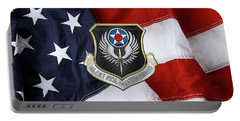 Air Force Special Operations Command -  A F S O C  Shield Over American Flag Portable Battery Charger by Serge Averbukh