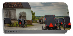Assorted Amish Buggies At Barn Portable Battery Charger